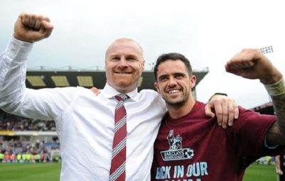 Dyche left and Danny Ings celebrate after Burnley win promotion
