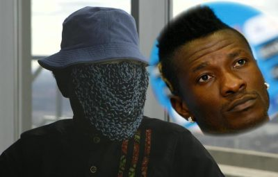 Ghana skipper, Asamoah Gyan (Right) And Anas Aremeyaw Anas (Left)