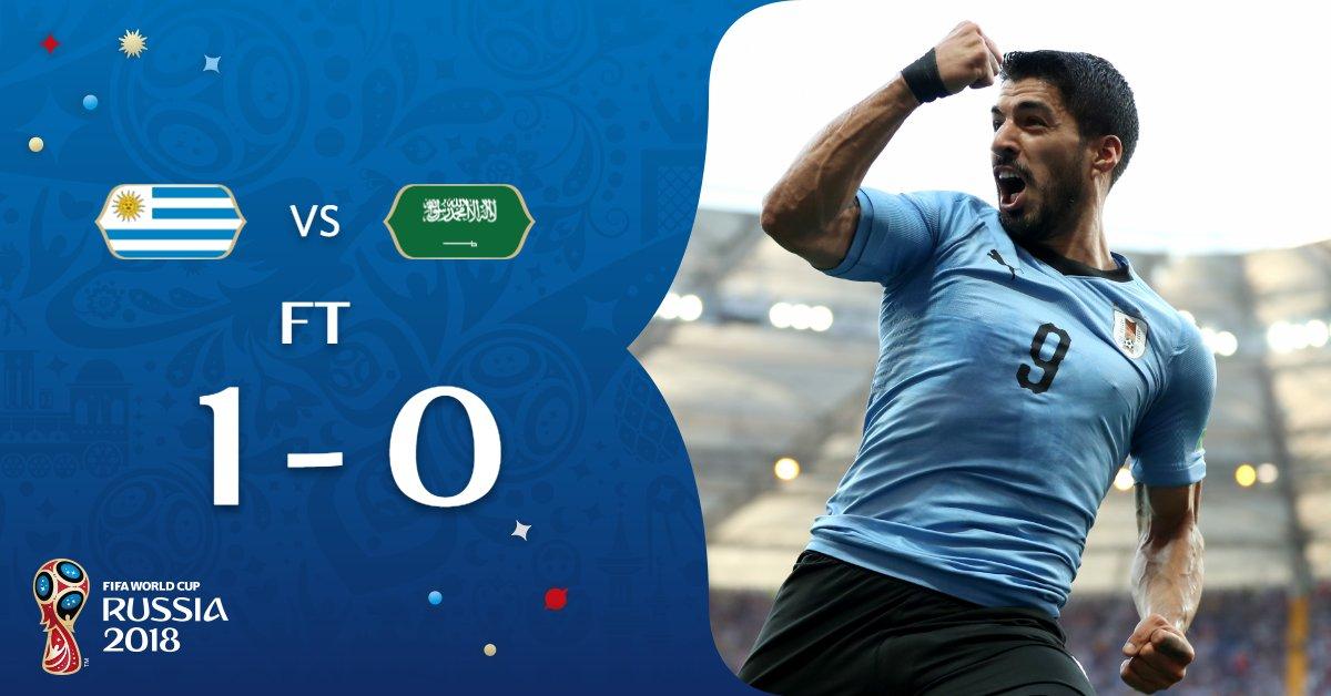 Luis Suarez (L) scores the only goal of the game between Uruguay vs Saudi Arabia