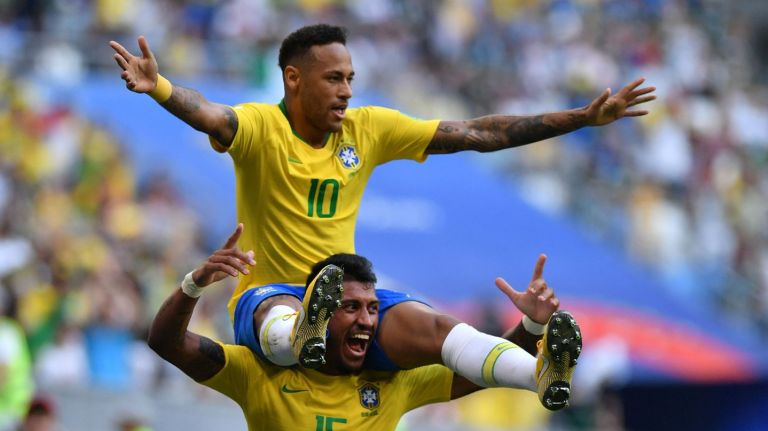Neymar celebrates with Paulinho after scoring the opening goal.