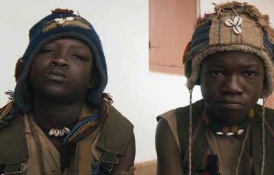 Striker with Abraham Attah on the set of 'Beast of No Nation'