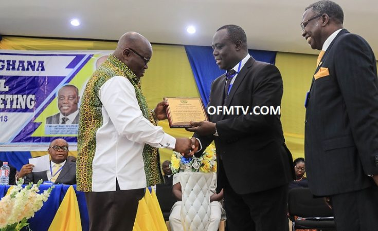 """President Akufo-Addo receiving a citation from Rev. Prof. Dr. Paul Frimpong Manso, the General Superintendent of """"Assemblies of God"""" Churches Ghana."""