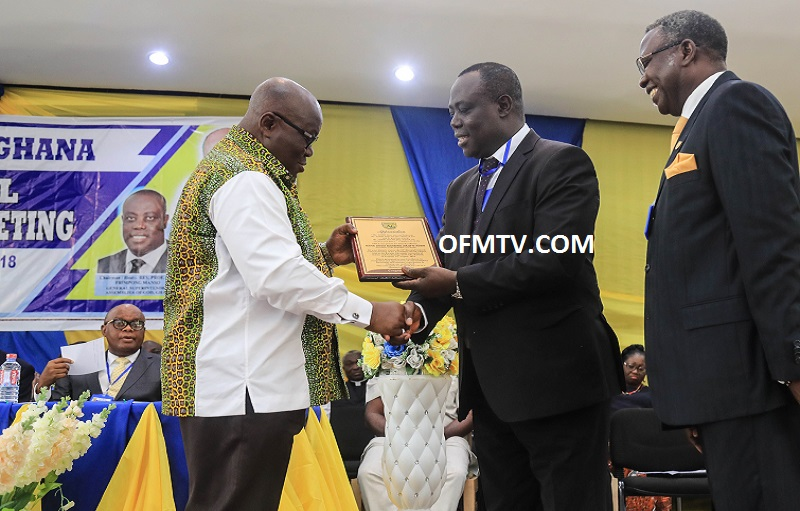 "President Akufo-Addo receiving a citation from Rev. Prof. Dr. Paul Frimpong Manso, the General Superintendent of ""Assemblies of God"" Churches Ghana."