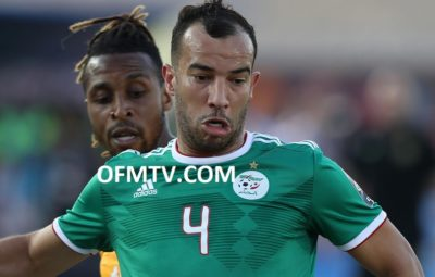 Djamel Benlamri of Algeria challenged by Wilfried Zaha of Ivory Coast during the 2019 Africa Cup of Nations Finals, quarterfinals match between Ivory Coast and Algeria at Suez Stadium, Suez, Egypt.