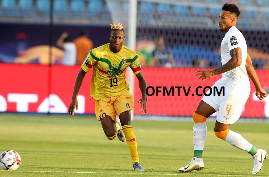 Jean Pphilippe Gbamin of Ivory Coast challenged by Moussa Djenepo of Mali during the 2019 Africa Cup of Nations at Egypt.