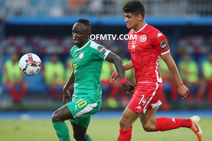 Sadio Mane of Senegal challenged by Drager Mohamed of Tunisia during the 2019 Africa Cup of Nations Semifinals match between Senegal and Tunisia at the 30 June Stadium, Cairo Egypt.